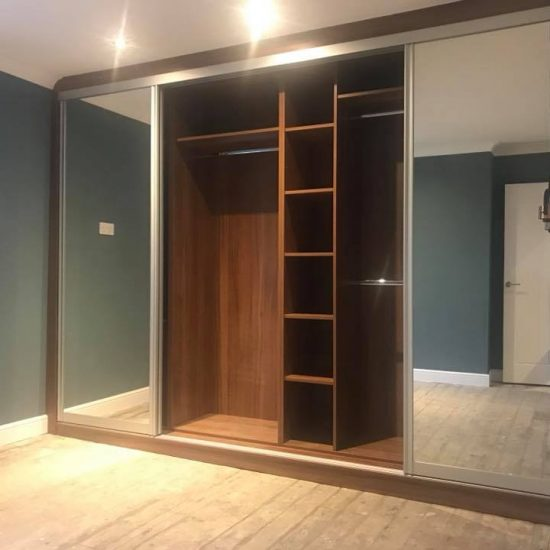 walnut and mirror shell with doors