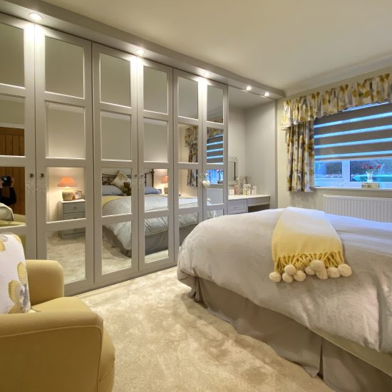 Cashmere 4 panel mirror hinged wardrobes fitted in Rotherham by Yorkshires most reputable fitted bedroom company #James Kilner