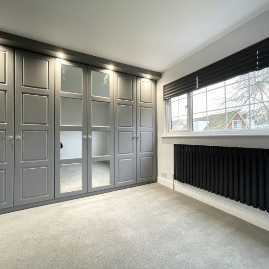 Dust grey 4 panel Santana hinged wardrobes with mirror fitted in Wakefield by James Kilner.