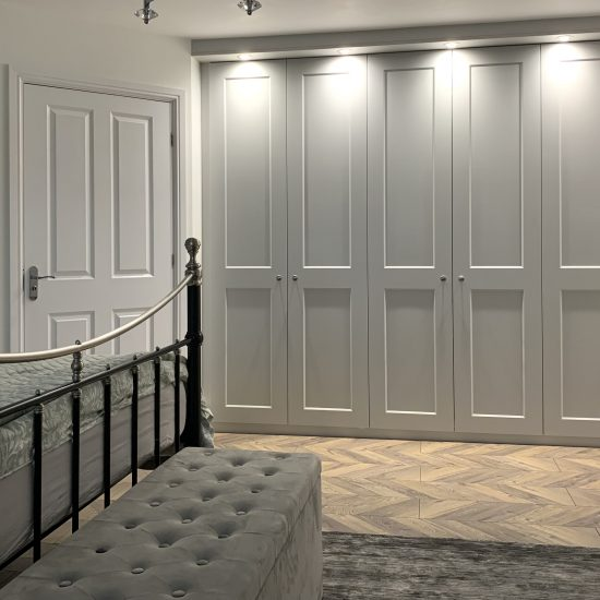 Eclipse style light grey hinged wardrobes fitted in Sheffield by James Kilner.