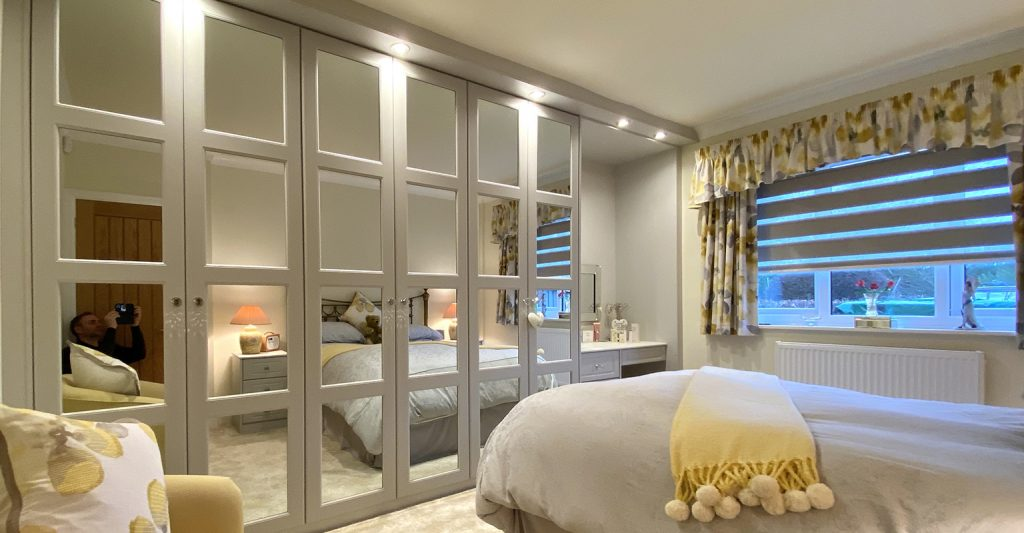 smaller box Cashmere 4 panel mirror hinged wardrobes fitted in Rotherham by Yorkshires most reputable fitted bedroom company #James Kilner