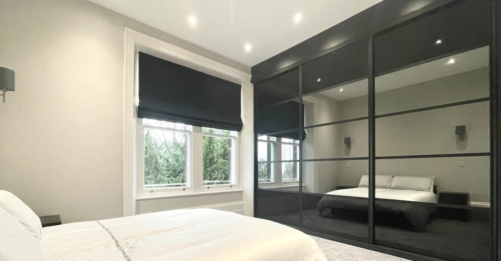 smaller box 5 Panel black and mirror bespoke sliding wardrobes fitted in Sheffield by James Kilner